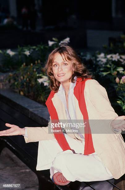 Portrait of American fashion model and actress Lauren Hutton as she poses on a sidewalk bench New York New York April 6 1977