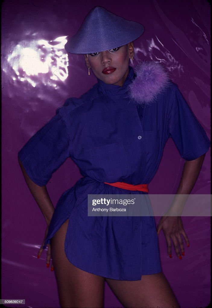 Portrait of American fashion model <a gi-track='captionPersonalityLinkClicked' href=/galleries/search?phrase=Toukie+Smith&family=editorial&specificpeople=1128567 ng-click='$event.stopPropagation()'>Toukie Smith</a> (born Doris Smith) as she poses against a purple background, New York, New York, early 1980s.