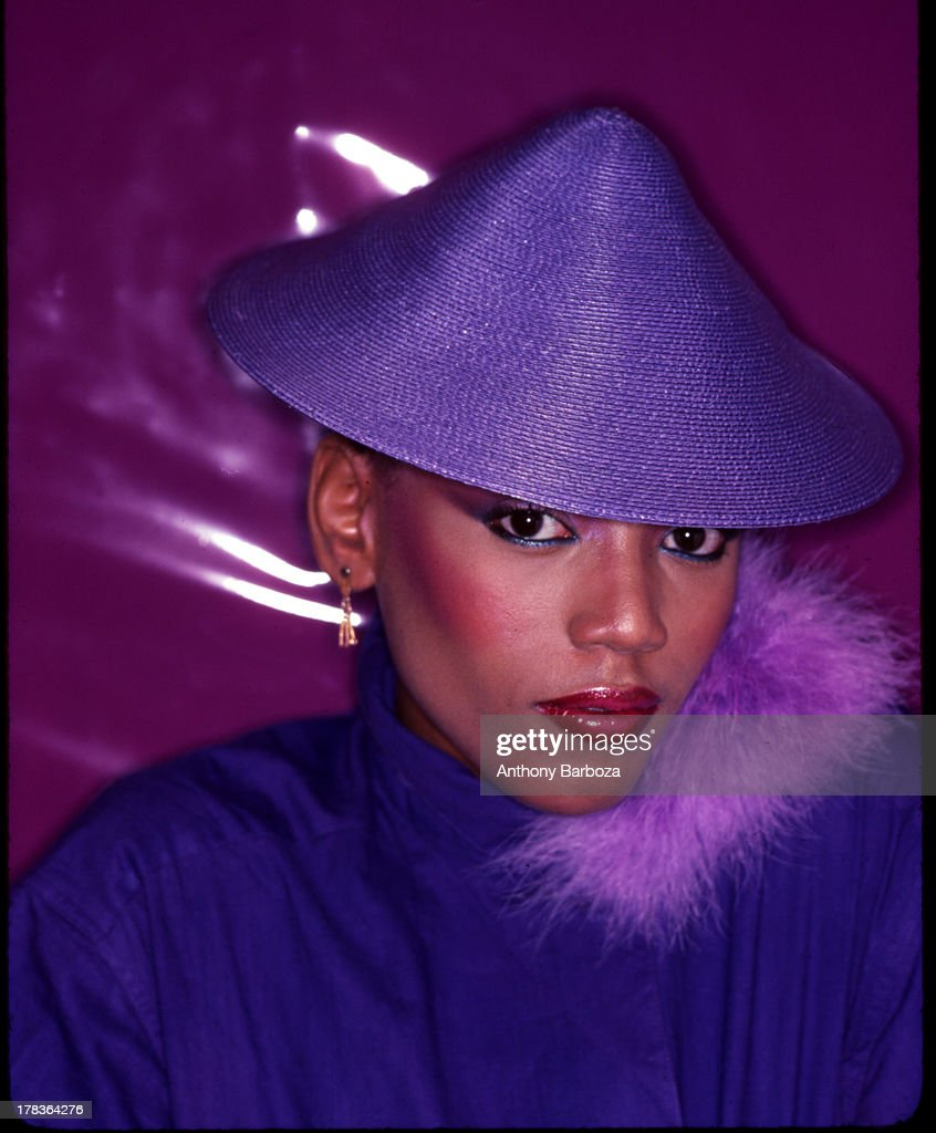 Portrait of American fashion model <a gi-track='captionPersonalityLinkClicked' href=/galleries/search?phrase=Toukie+Smith&family=editorial&specificpeople=1128567 ng-click='$event.stopPropagation()'>Toukie Smith</a> (born Doris Smith) as she poses, dressed in purple, with a matching, conical hat, New York, New York, early 1980s.
