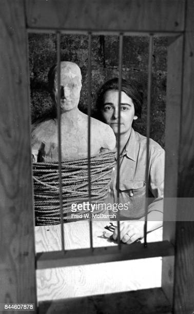 Portrait of American feminist activist and artist Kate Millett as she poses with one of her sculptures in her at her studio New York New York July 7...