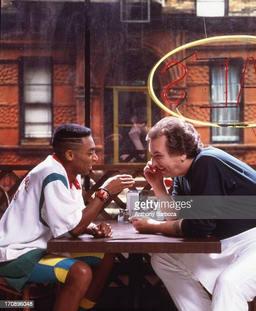 Portrait of American film director and actor Spike Lee and actor Danny Aiello on the set of their film 'Do the Right Thing' New York 1989