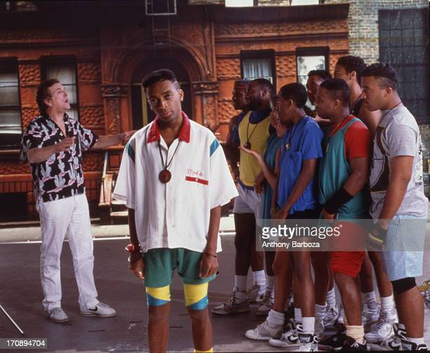 Portrait of American film director and actor Spike Lee on the set of his film 'Do the Right Thing' New York 1989 Among the cast behind him is actor...