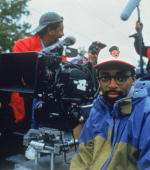Portrait of American film director Spike Lee next to a camera during the filming of his movie 'Crooklyn' 1994