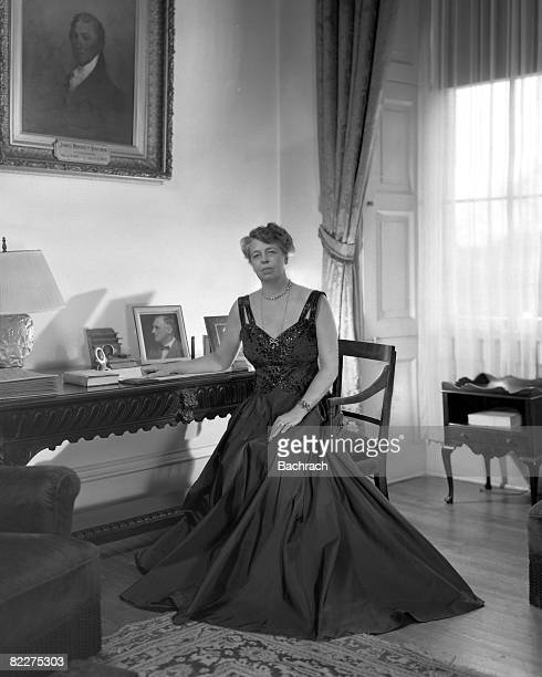 Portrait of American First Lady Eleanor Roosevelt as she sits at a writing table in the White House Washington DC 1941