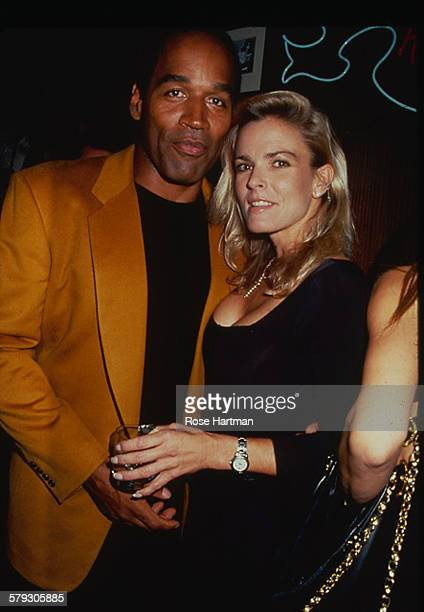 Portrait of American former foorball player OJ Simpson and his wife Nicole Brown as they attend a party at the Harley Davidson Cafe New York New York...