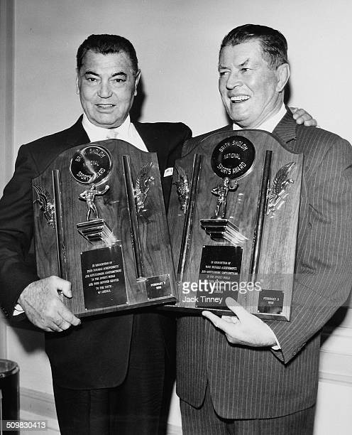 Portrait of American heavyweight boxer Jack Dempsey and Gene Tunney pose with their Brith Sholom National Sports awards Philadelphia Pennsylvania...