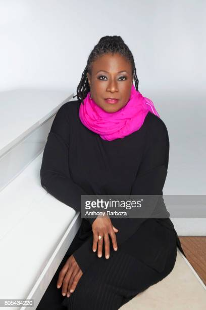 Portrait of American Jazz musician and composer Geri Allen as she poses seated at a piano 2015