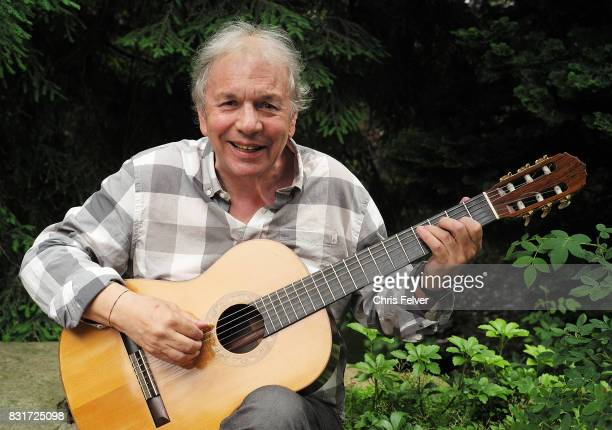 Portrait of American Jazz Ralph Towner as he sits outdoors and plays an acoustic guitar Rome Italy June 15 2017