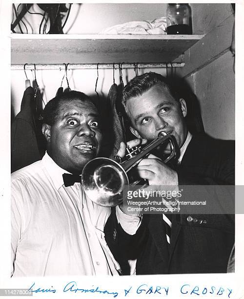 Portrait of American jazz trumpeter and singer Louis Armstrong and singer and actor Gary Crosby backstage at Basin Street New York New York 1940s...