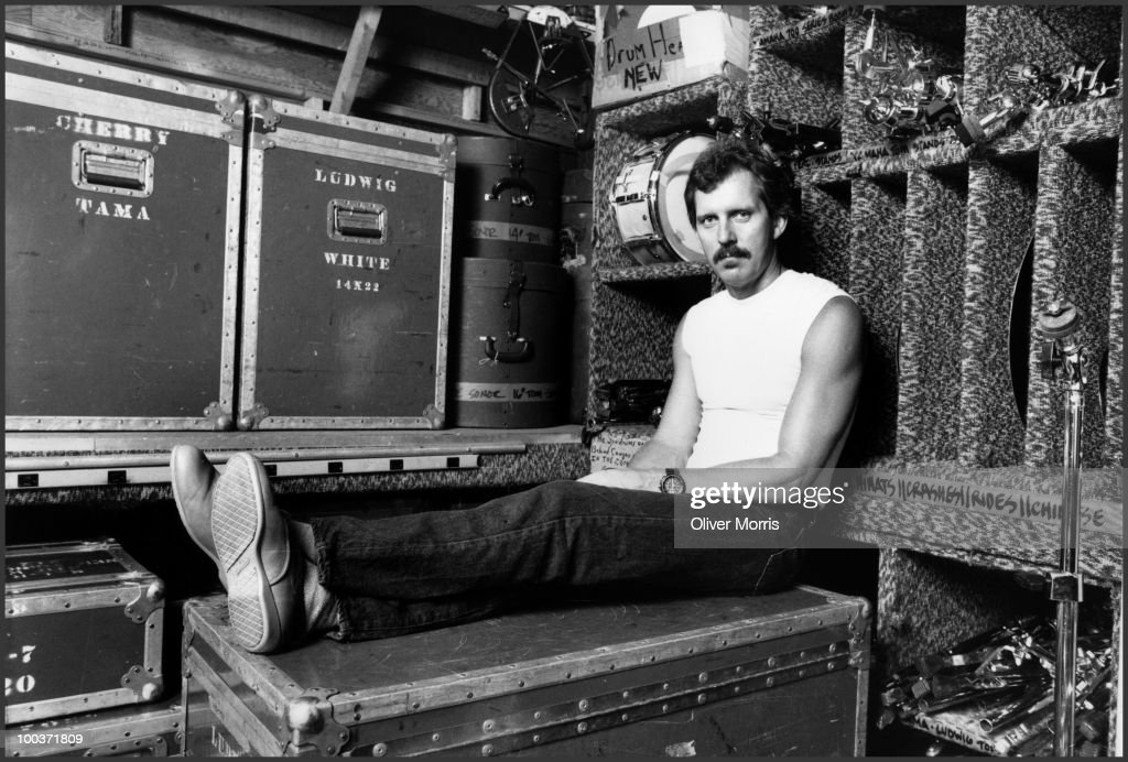 Portrait of American jazz vocalist Michael Franks as he sits on a trunk at SIR studios, New York, New York, August 3, 1985.