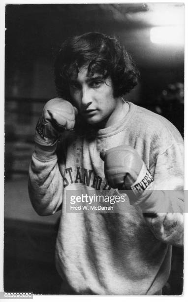 Portrait of American journalist and editor Howard Blum as he poses in a sweatshirt and boxing gloves New York New York February 10 1971