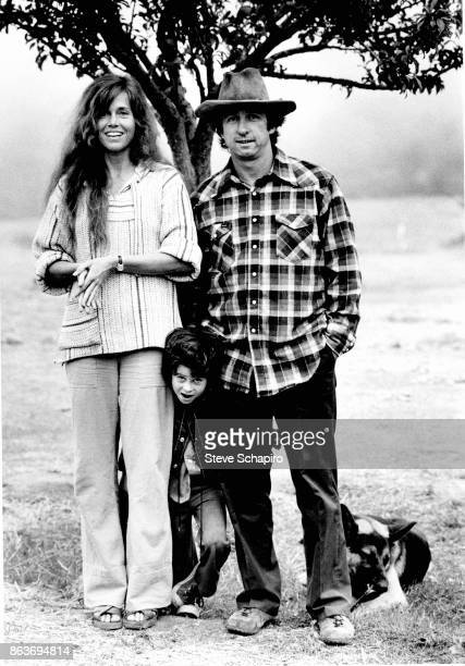 Portrait of American married couple actress Jane Fonda and politician activist Tom Hayden and their son Troy Garity as they pose with their dog in...