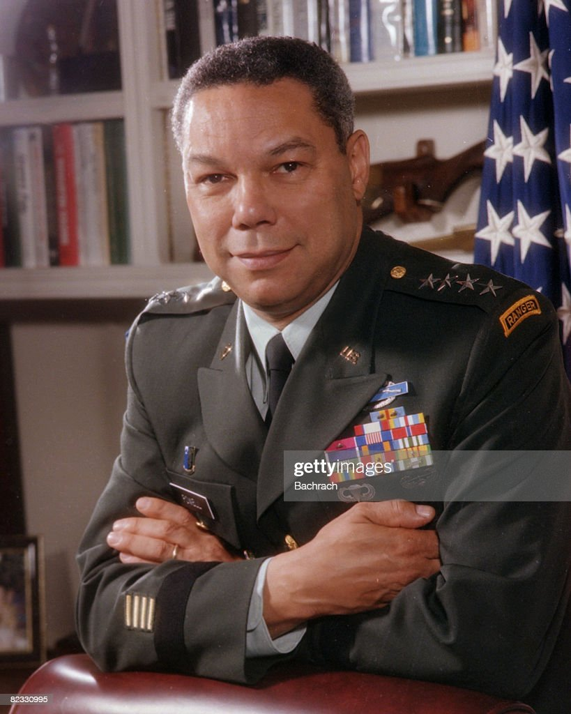 Portrait of American military commander and Chairman of the Joint Chiefs of Staff (from 1989 - 1993), General <a gi-track='captionPersonalityLinkClicked' href=/galleries/search?phrase=Colin+Powell&family=editorial&specificpeople=118599 ng-click='$event.stopPropagation()'>Colin Powell</a> as he leans, arms crossed, on the back of a chair in an office in the Pentagon, Washington, D