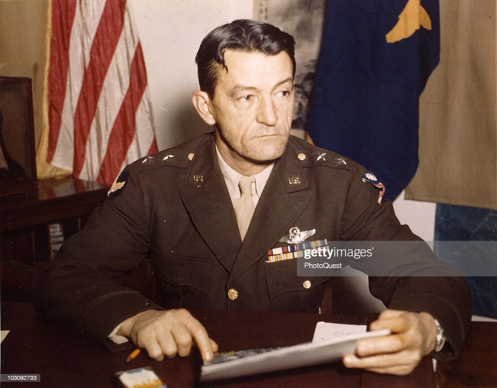Portrait of American military officer Major General Claire Lee Chennault (1893 - 1958), commander of the 14th Air Force in China, as he sits at his desk and reviews docments, 1940s. Chennault's uniform features both US and Chinese insignia; Chennault's command was founded as the 1st American Volunteer Group, or the Flying Tigers, which defended China from Japanese forces during World War II.