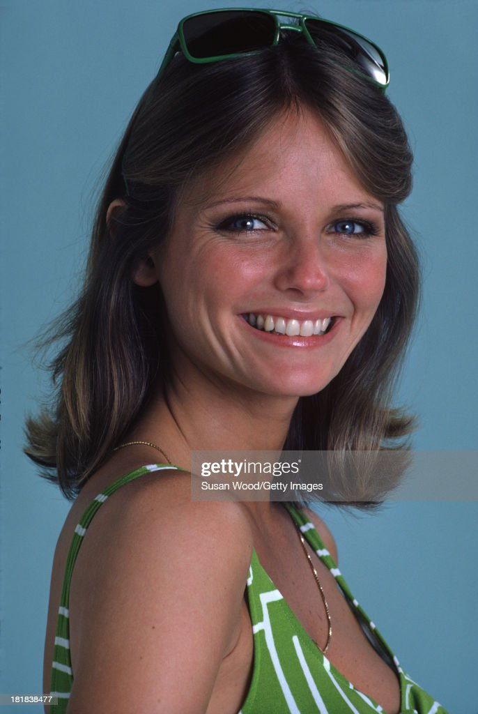 Portrait of American model and actress <a gi-track='captionPersonalityLinkClicked' href=/galleries/search?phrase=Cheryl+Tiegs&family=editorial&specificpeople=211403 ng-click='$event.stopPropagation()'>Cheryl Tiegs</a> as she poses, dressed in a green and white stripped bikini top and green rimmed sunglasses, 1974. The photo was taken as part of a cover shoot for the May 1974 issue of Women's Own magazine.