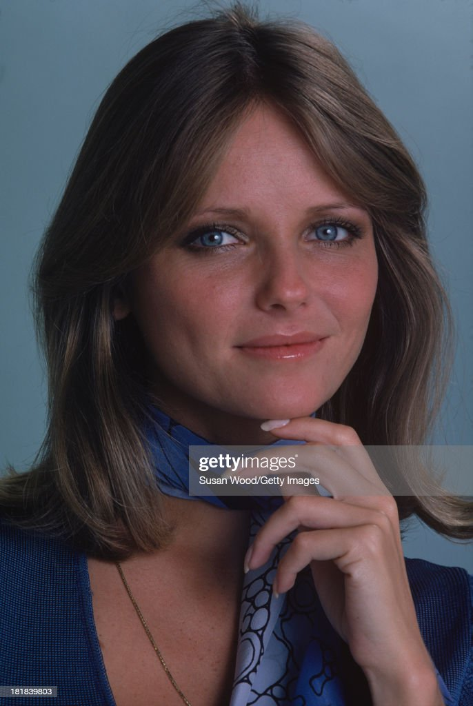 Portrait of American model and actress <a gi-track='captionPersonalityLinkClicked' href=/galleries/search?phrase=Cheryl+Tiegs&family=editorial&specificpeople=211403 ng-click='$event.stopPropagation()'>Cheryl Tiegs</a> as she poses, dressed in a blue-print neck scarf and a blue, short-sleeved, V neck sweater, 1974. The photo was taken as part of a cover shoot for the May 1974 issue of Women's Own magazine.
