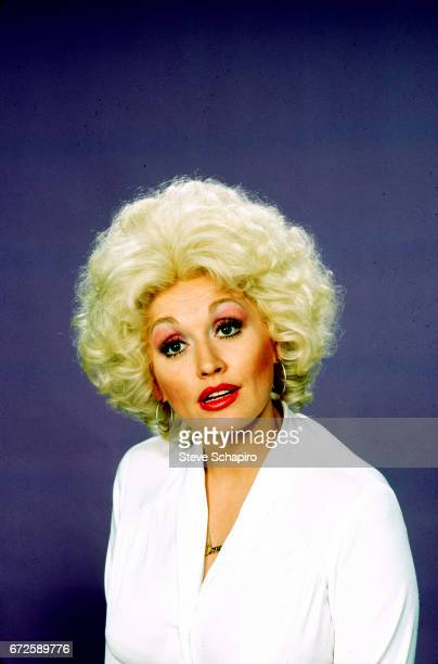 Portrait of American musician and actress Dolly Parton in costume for her film '9 to 5' California 1980