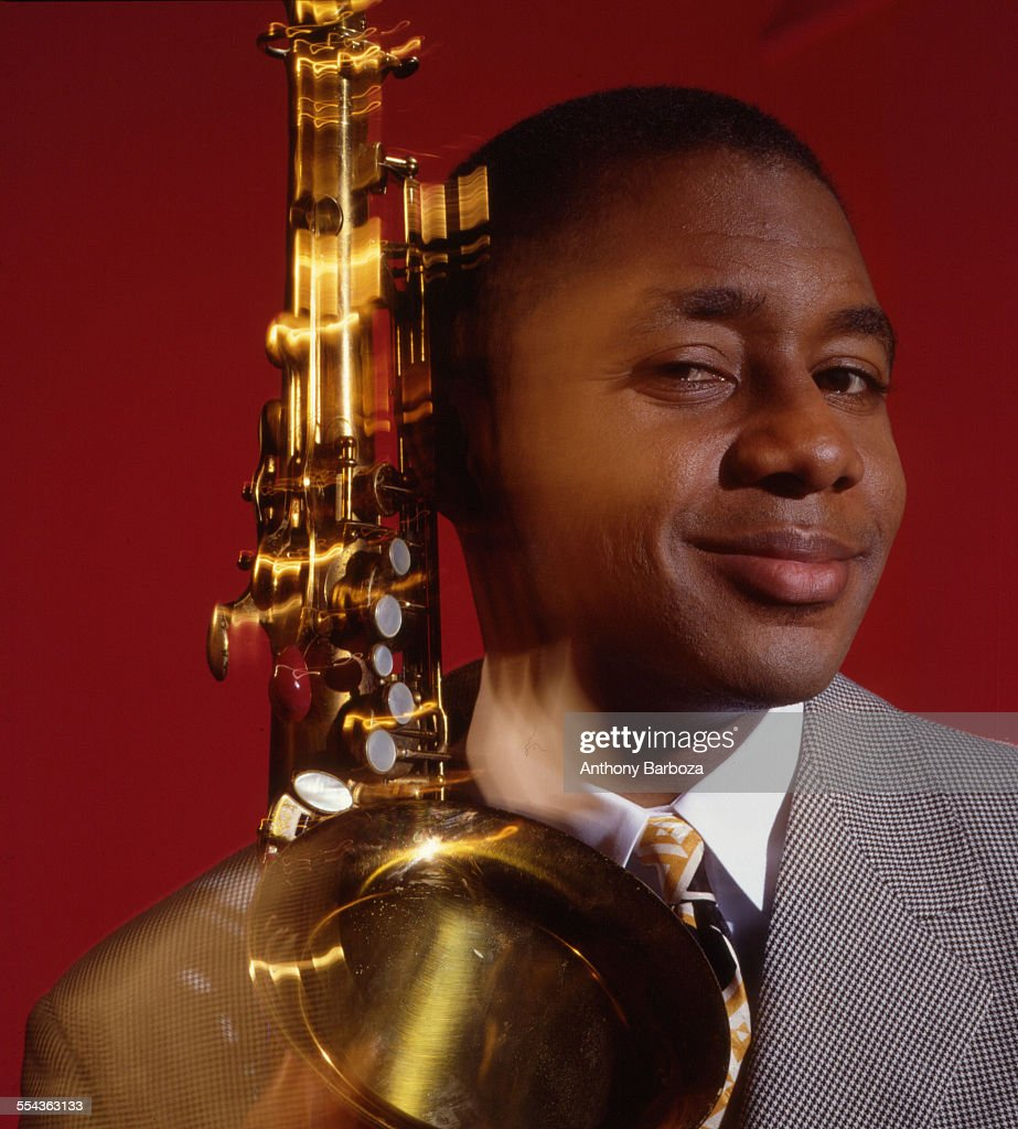 Portrait of American musician Branford Marsalis as he poses with a saxophone New York 1995