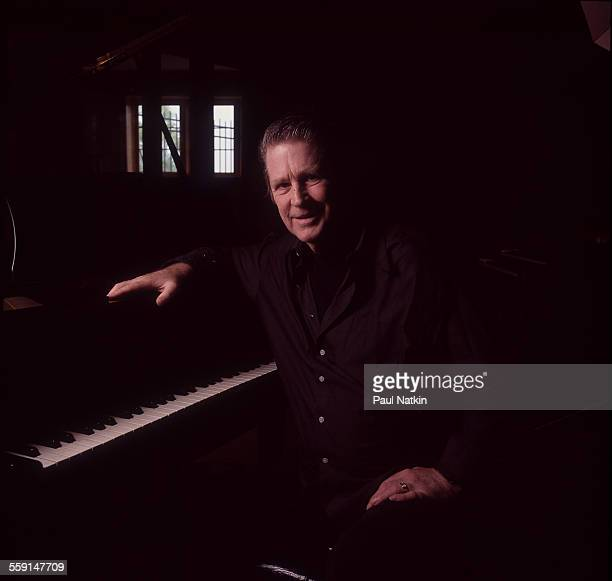 Portrait of American musician Brian Wilson as he sits at a piano in his home St Charles Illinois July 12 1998