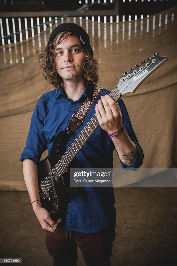 Portrait of American musician Erick Hansel guitarist with progressive rock group Chon photographed backstage at ArcTanGent Festival in Somerset on...