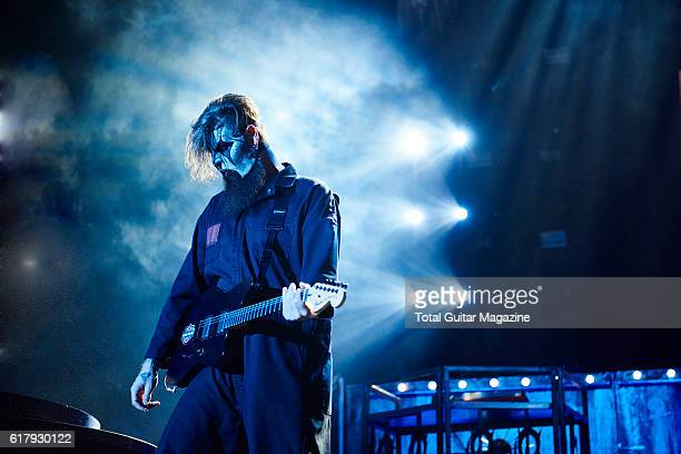 Portrait of American musician Jim Root guitarist with heavy metal group Slipknot performing live on stage at Motorpoint Arena in Cardiff on February...