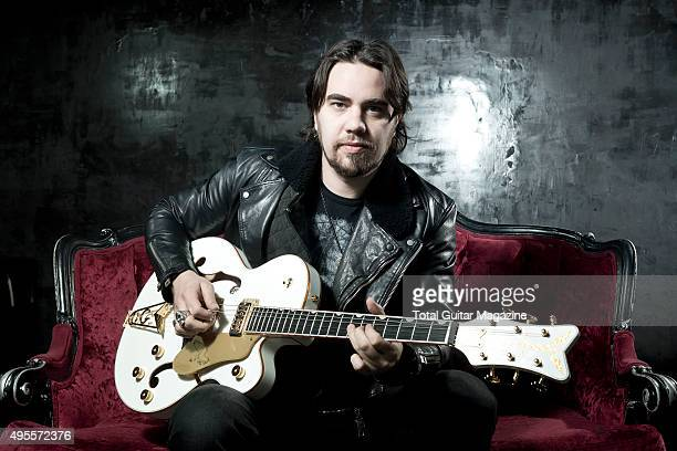 Portrait of American musician Joe Hottinger guitarist with hard rock group Halestorm photographed before a live performance at Rock City in...