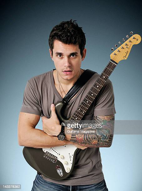 Portrait of American musician John Mayer posing with his signature Fender Stratocaster backstage at the Hard Rock Calling festival in London on June...