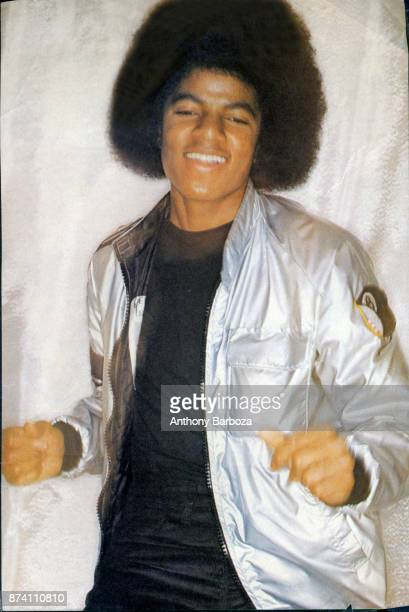 Portrait of American musician Michael Jackson dressed in a shiny silver jacket as he smiles November 1977