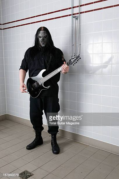 Portrait of American musician Mick Thompson guitarist with heavy metal group Slipknot posing with his Ibanez MTM1 guitar taken on December 9 2008