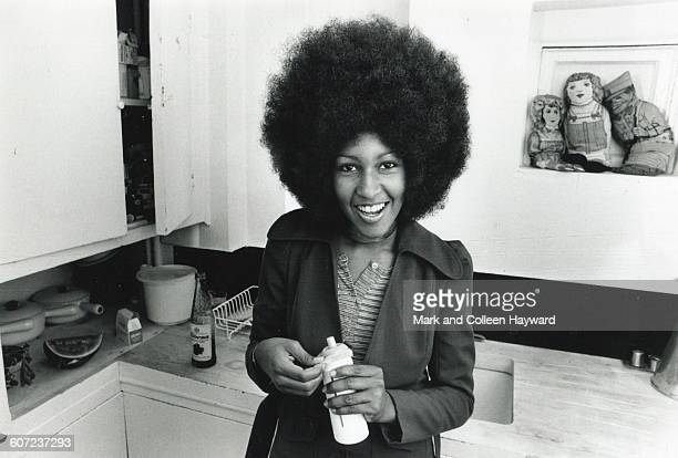 Portrait of American musician model and actress Marsha Hunt as she poses in Mick Jagger's kitchen London England late 1960s or early 1970s
