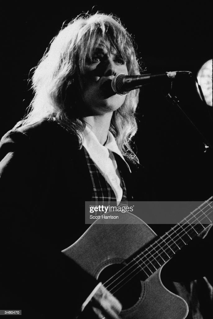 Portrait of American musician Nancy Wilson of the rock group Heart performing 1995
