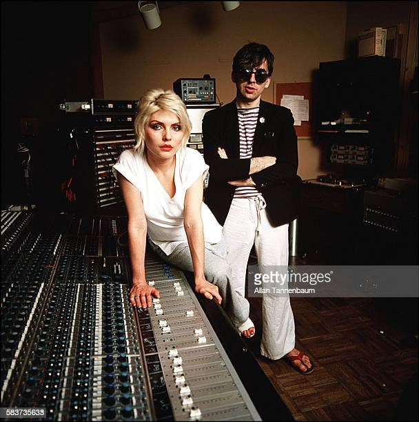 Portrait of American musicians Debbie Harry and Chris Stein both of the group Blondie as they pose at the mixing desk in the Mediasound recording...