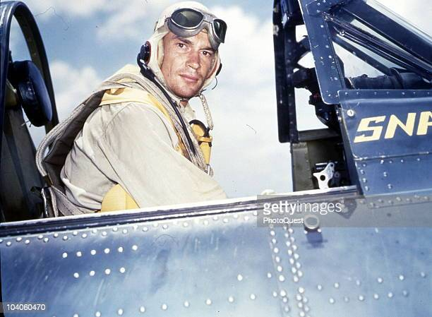 Portrait of American Navy pilot Al Wright as he sits in the cockpit of a Douglas SBD5 Dauntless plane on the deck of the USS Yorktown October 1943