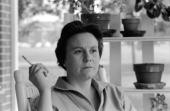 Portrait of American novelist Harper Lee smokes a cigarette as she sits on the porch of her parents home Monroeville Alabama May 1961 Lee's novel 'To...