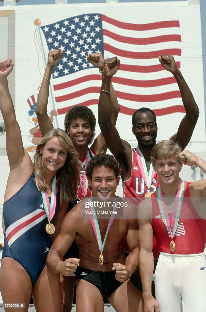 Portrait of American Olympic gold medalists at the 1984 Summer Olympics including swimmer Nancy Hogshead (far left), basketball player Cheryl Miller (back row, center), hurdler Edwin Moses (back row, right), gymnast Peter Vidmar (front row, right), and diver Greg Louganis (front row, center).