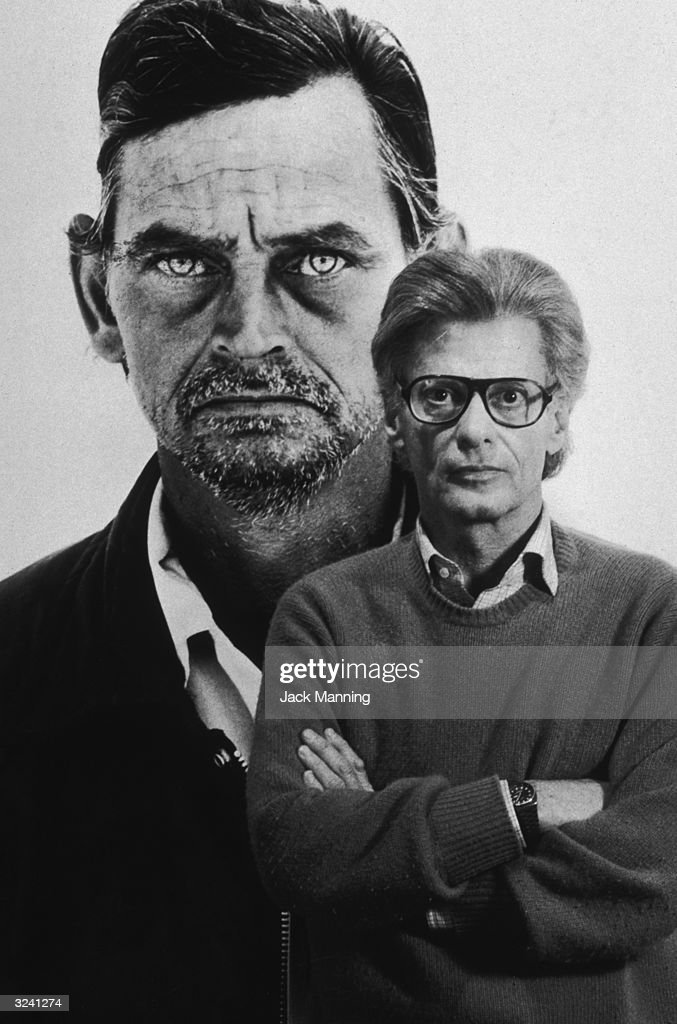 Portrait of American photographer Richard Avedon standing in front of his photograph 'Unemployed Ranch Hand' which appears in his book 'In the...