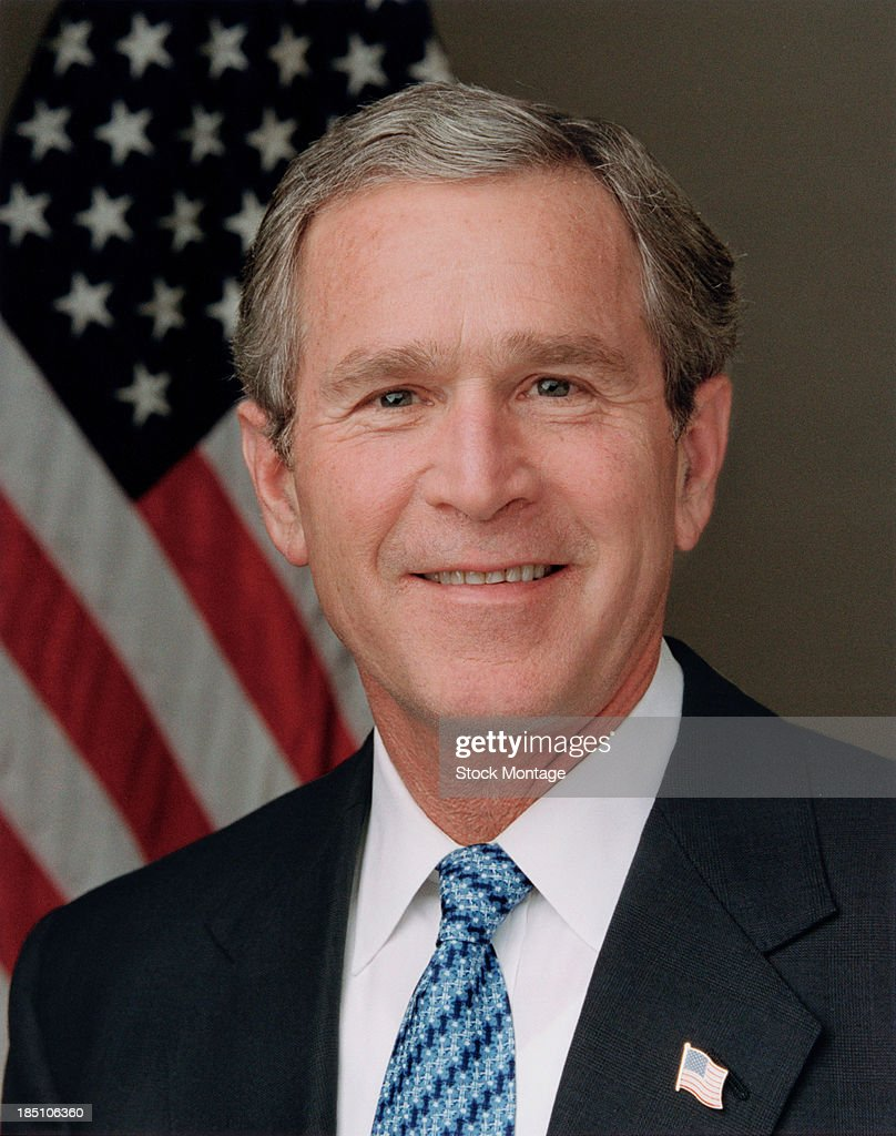 Portrait of American politician and US President <a gi-track='captionPersonalityLinkClicked' href=/galleries/search?phrase=George+W.+Bush&family=editorial&specificpeople=122011 ng-click='$event.stopPropagation()'>George W. Bush</a> as he poses for his Official Portrait in the Roosevelt Room of the White House, Washington DC, January 14, 2003.