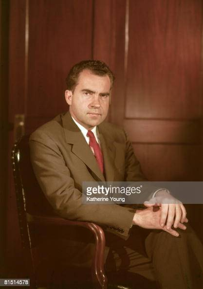 Portrait of American politician and US President Richard Nixon as he sits in a chair with his hands on his crossed legs 1960s