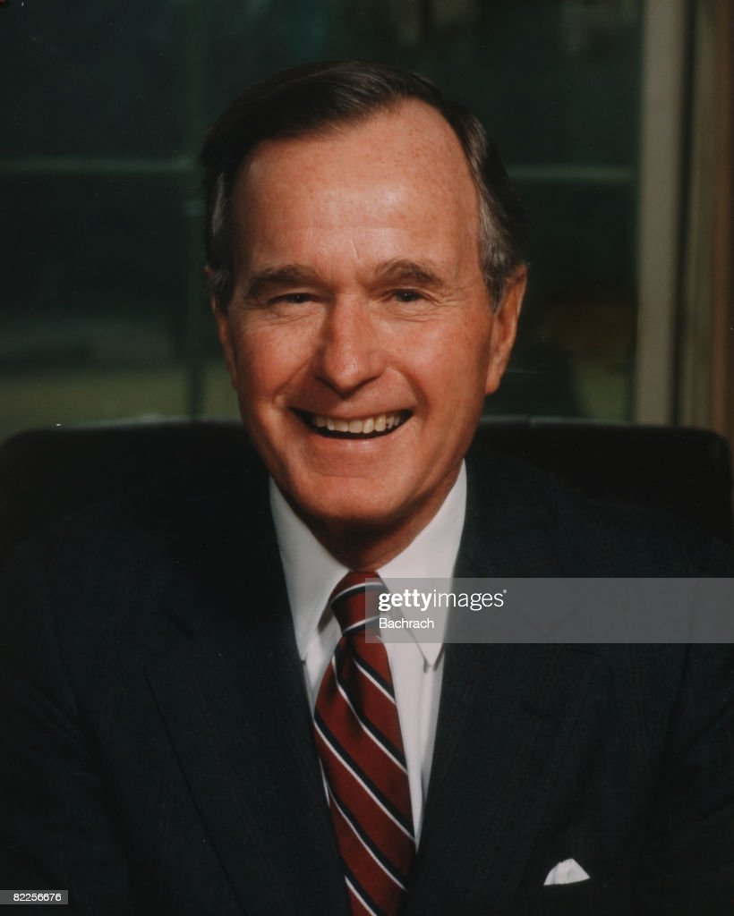 A portrait of American politician George Herbert Walker Bush, the 41st President of the United States, in the Oval Office, Washington, D