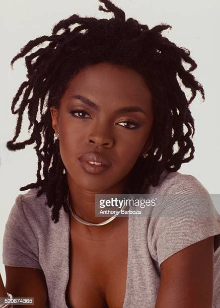 Portrait of American pop and rhythm blues musician Lauryn Hill as she poses against a white background 1998