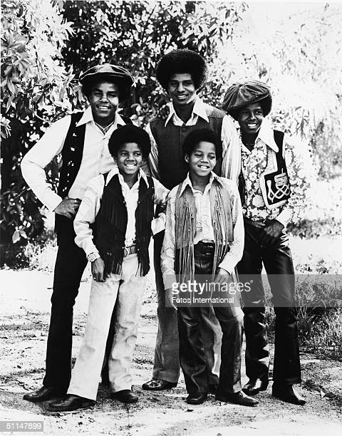 Portrait of American pop group the Jackson 5 standing outdoors early 1970s From left back row Tito Jackson Jackie Jackson and Jermaine Jackson from...