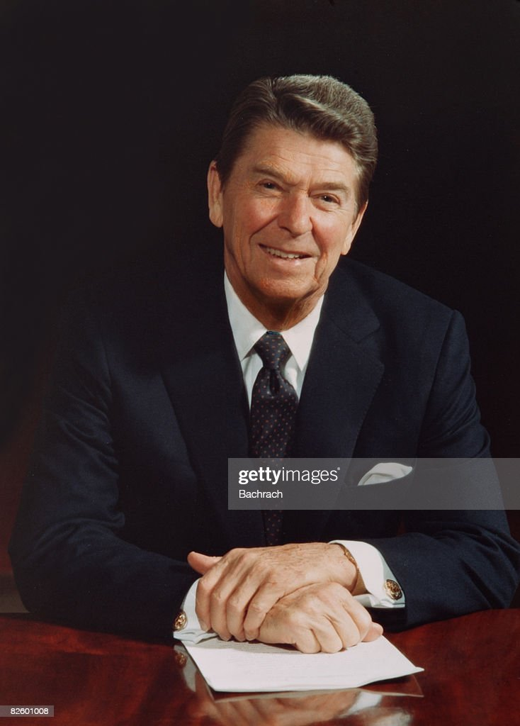 Portrait of American President <a gi-track='captionPersonalityLinkClicked' href=/galleries/search?phrase=Ronald+Reagan+-+US+President&family=editorial&specificpeople=69998 ng-click='$event.stopPropagation()'>Ronald Reagan</a> (1911 - 2004) as he sits at a table in the White House and smiles, Washington, DC, 1983.