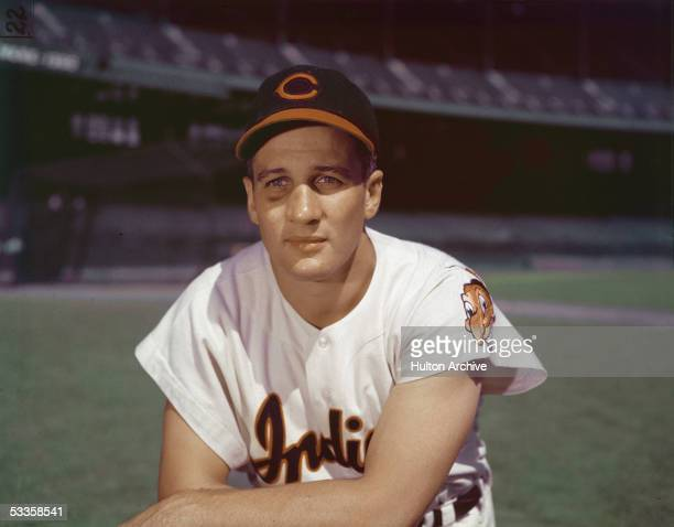 Portrait of American professional baseball player Al Rosen third baseman for the Cleveland Indians kneeling in an empty stadium 1950s