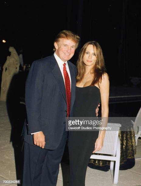 Portrait of American real estate developer Donald Trump and his girlfriend former model Melania Knauss at the MaraLago club Palm Beach Florida...