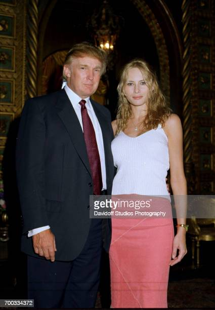 Portrait of American real estate developer Donald Trump and his girlfriend former model Melania Knauss during an Easter event at the MaraLago estate...