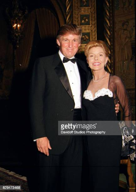 Portrait of American real estate developer Donald Trump and philanthropist Lois Pope as they pose together during the official opening party of the...