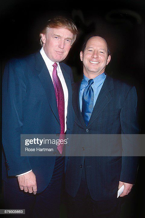 Portrait of American real estate developer Donald Trump (left) and magazine publisher Ron Galotti as they attend a party in Trump Tower, New York, New York, 1997.