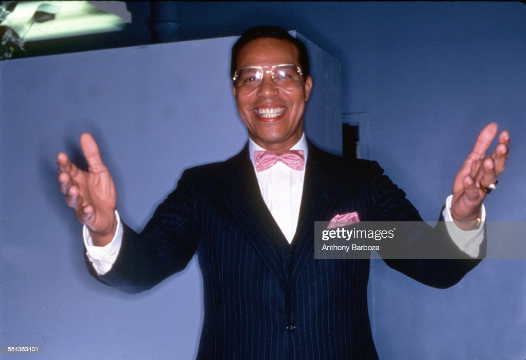 Portrait of American religious leader <a gi-track='captionPersonalityLinkClicked' href=/galleries/search?phrase=Louis+Farrakhan&family=editorial&specificpeople=215023 ng-click='$event.stopPropagation()'>Louis Farrakhan</a> (born Louis Wolcott) as he grins and stands with his arms outstretched, New York, 1984.