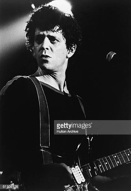 Portrait of American rock and roll musician Lou Reed on stage with a guitar 1970s