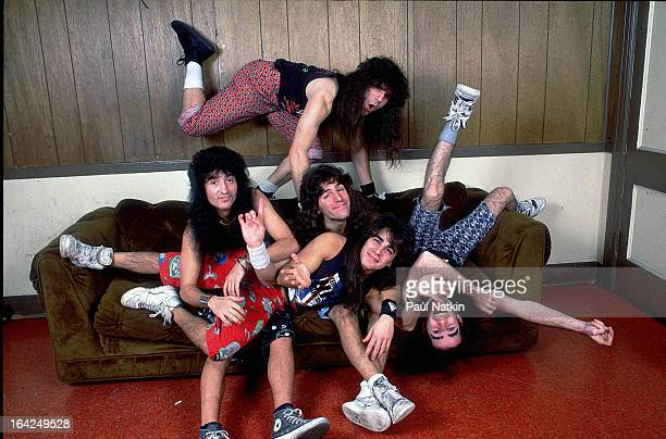 Portrait of American rock band Anthrax as they pose backstage Milwaukee Wisconsin April 26 1989 Pictured are Joey Belladonna Charlie Benante Frank...